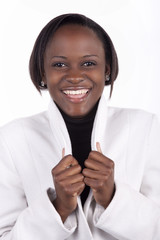 Smiling young South African woman on a white