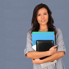 Student holding pile of files