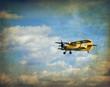Old flying biplane, retro aviation background