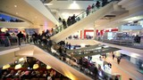 Many people move on escalators in floors shopping center