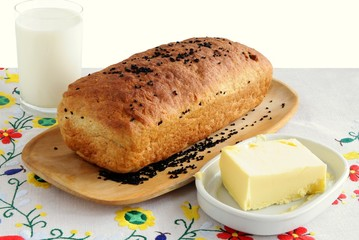 loaf of bread,butter and milk