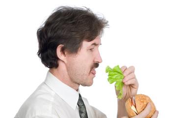 Man will get from hamburger sheet salad and eats
