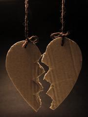 Broken paper heart hanging on rope