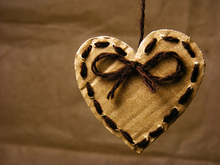 Paper heart tied on wire. Love symbol.