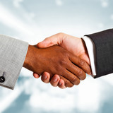 Multiethnic business handshake