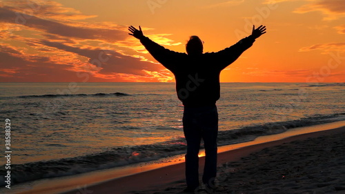 Man Praying At Sunset