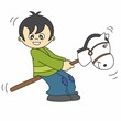 Niño jugando con un caballo de madera
