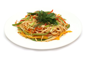 Noodles with vegetables isolated on white