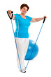 Senior woman doing fitness exercise in gym