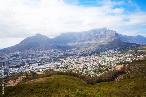 cityscape of cape town and misty table mountain
