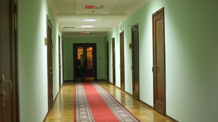 deputy assistant entering corridor and approaching