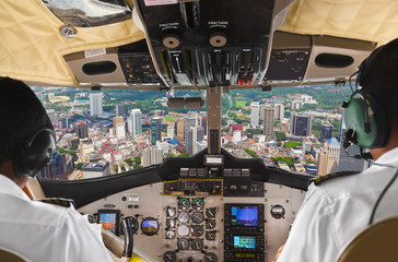 Pilots in the plane cockpit and city
