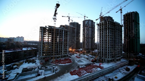 Labourers at construction site dormitory area at background