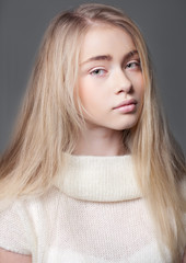 Portrait of a beautiful teenager girl with long  hair in studio