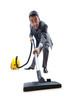 Businessman with vacuum cleaner on white