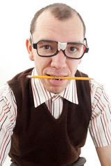 Nerdy guy biting pencil