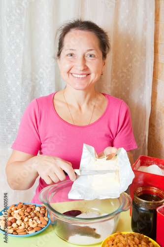 woman adds margarine into dish