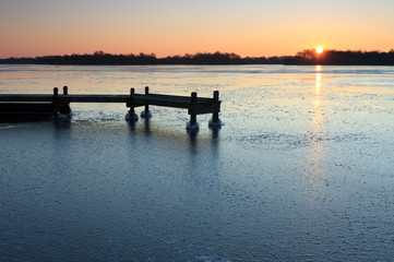 Jetty in the ice of a frozen lake.