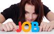 Mädchen bildet das Wort Job aus bunten Buchstaben
