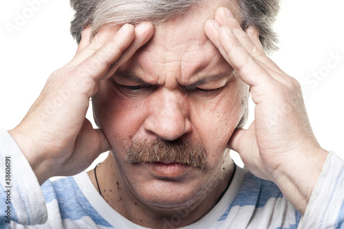 mature man having very strong pain isolated on white
