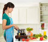 woman cooking in the kitchen poster