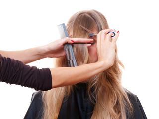 hairdresser cutting models fringe