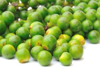 macro green peppercorns