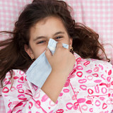 Hspanic girl sick with the flu and sneezing