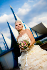 beautiful young bride with a bouquet on the nature