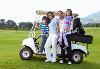 Family with a golf cart