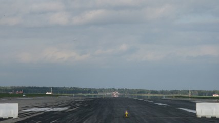Planes by turns fly up and land on take-off field at airport