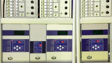 Control room with monitors, scheme, gages and switches