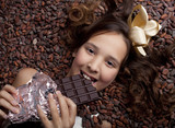 Fototapety girl with chocolate on cocoa background