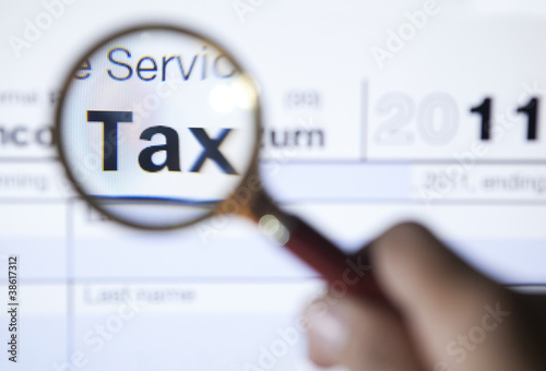 Tax form 1040 with magnifying glass