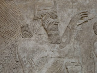 Ancient Assyrian wall carving of a man