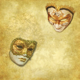 two Venetian masks on a rich golden textured background - 38621156