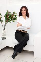 Hispanic lady sitting on couch