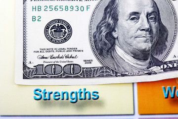 Hundred dollar bill and swot analysis close up