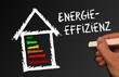 Tafel mit Hand - Energieeffizienz im Bau