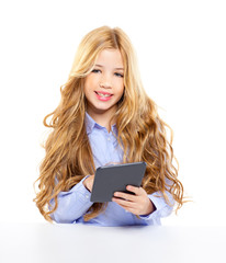 blond student kid with ebook tablet pc portrait in desk
