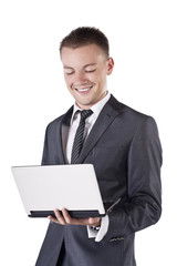 Businessman with open laptop in his hands, smile