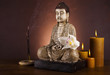 Buddha and incense and candle