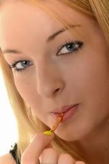 Young beautiful woman eating salt stick