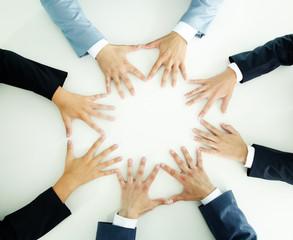 Hands of businesspeople