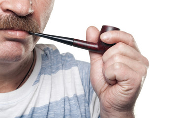 mature caucasian man holding smoking pipe in hand isolated