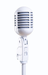 White vintage microphone over white background