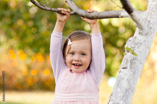 Beautiful child playing with tree