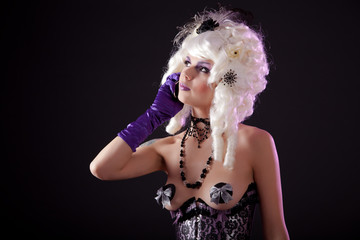 Funny shot of burlesque woman speaking on phone