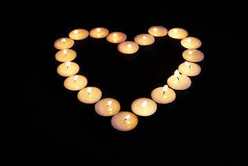 Heart shape made from candles