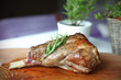 Roasted leg of lamb with rosemary on the cutting board